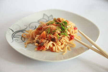 Spaghetti on white background with chinese sticks. Stock Photo