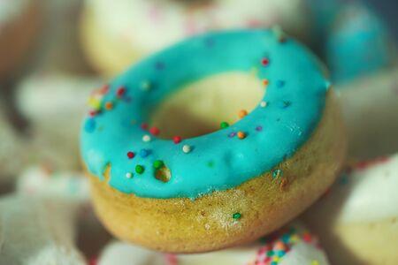 Delicious pretzels with blue glaze Stock Photo