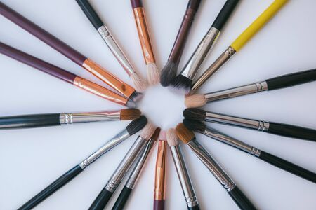 Makeup brush in the form of a circle on white backround.