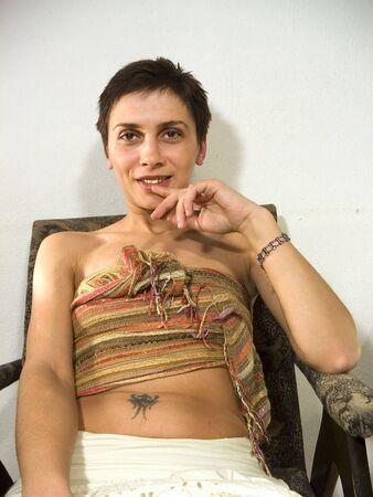 Woman erotic pose with tatoo Stock Photo - 333781