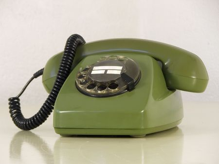 dialplate: Green phone with broken dial-plate Stock Photo