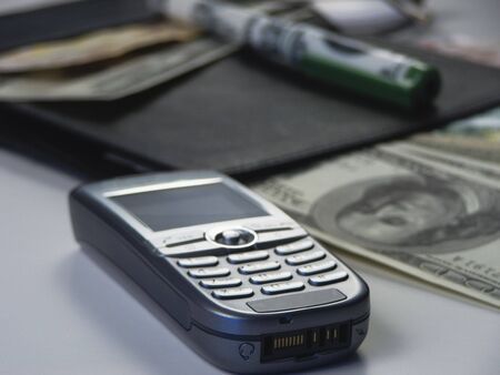 Business objects - focus on bottom of mobile phone Stock Photo