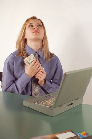 Business woman in office with earn money Imagens