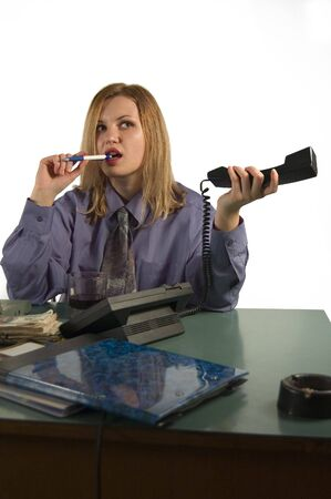Businesswoman with comunication objects at the office photo