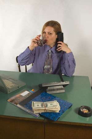 Businesswoman with comunication objects at the office and money photo