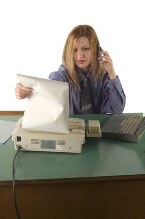 Businesswoman  talking at phone and send fax material Stock Photo - 505292
