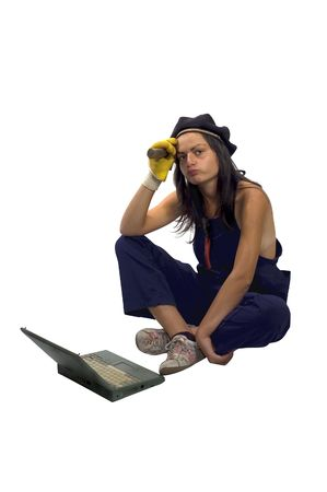 casualy: Brunette worker with laptop, hammer and gloves in working clothes