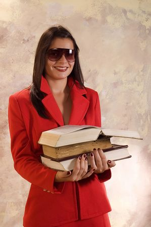 Teacher  in red clothes holding books for school photo