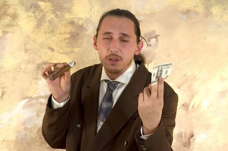Businessman with cigar and his money photo