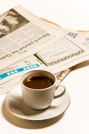 Newspapers and hot coffe, isolated on white photo