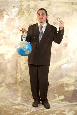 parody: Businessman holding globe with money - Parody on earning money