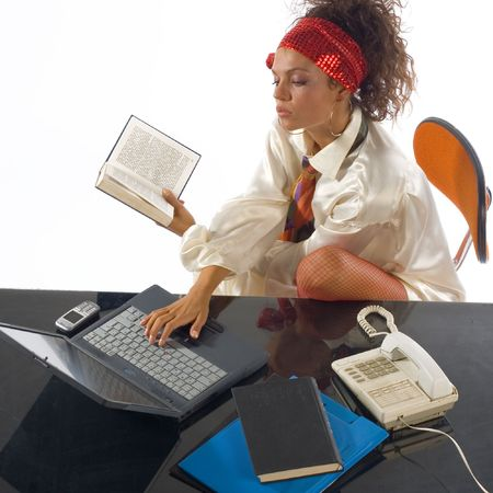 Young woman secretary at working place in office photo