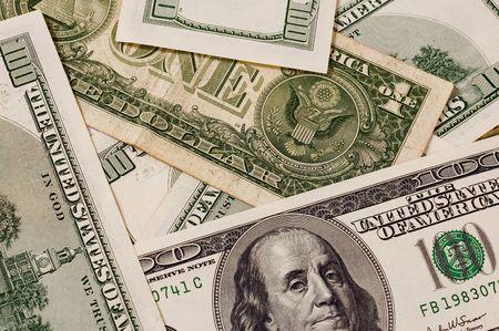 A backgrounds of 100 dollars bill taken macro details