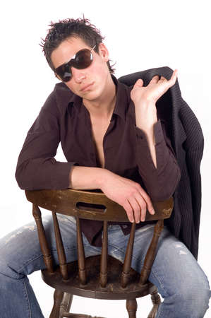 sunglassess: Young male fashion model sitting with sunglassess , isolated on white backgrounds