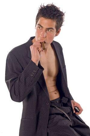 unbuttoned: Young man sitting unbuttoned till half and smoking cigarette
