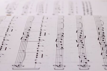 transcribe: Composition of music notes written on paper