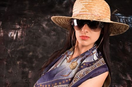 earnestly: Portrait of  brunette woman with hat and sunglasses
