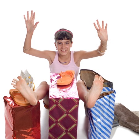 Glad young child with gifts after shopping Stock Photo - 1413861