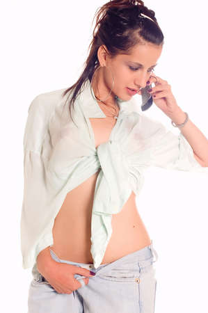 A sexual woman in a wet shirt making a call photo