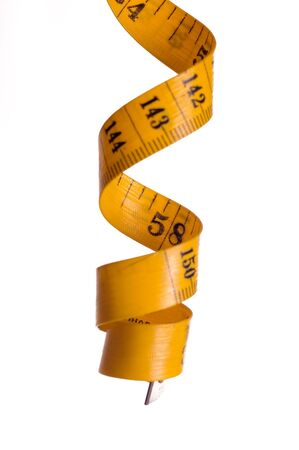 metre: Spiral metre for measuring on white backgrounds Stock Photo
