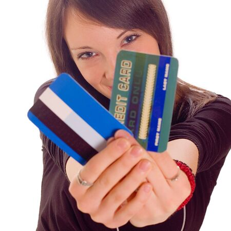 creditcards: Young woman holding online credit cards on white backgrounds