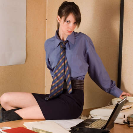 rowth: Young pretty business wom?n in everyday job at office Stock Photo