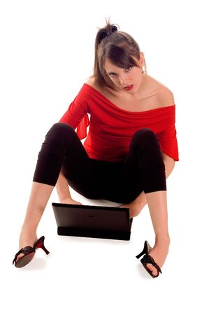 erotical: Young woman using his laptop sitting on floor