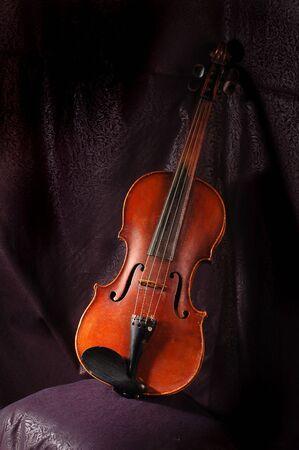 A vintage violin instrument on dark background