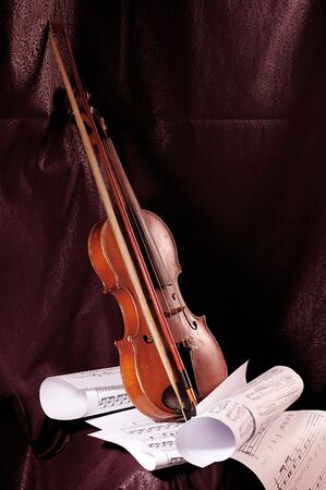 Violin and musical note on sheet of paper Stock Photo