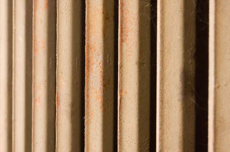 rustiness: Old rusty radiator, focus on middle part of radiator, DOF is shalow