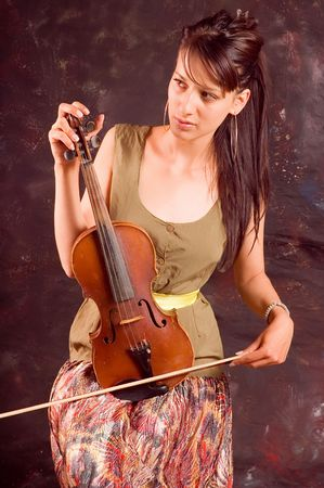 soprano: A young brunette woman playing solo her violin