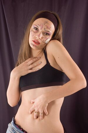 erotical: Young sensual girl with drawn ornament on face