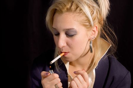 cigar smoking woman: Young beauty blondie girl enjoyment with smoking cigarette