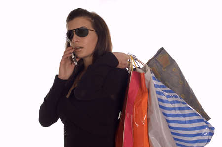sunglassess: Girl with sunglasses holding bags and making call
