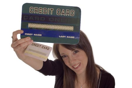 creditcards: Young woman holding credit card, numbers are made up     Stock Photo