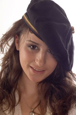 womanly: Portrait of beautiful young woman with cap
