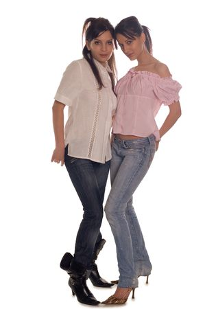womankind: Two young girls posing in fashion shot