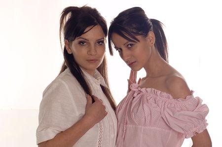 womankind: Fashion shot a two young pretty brunette women