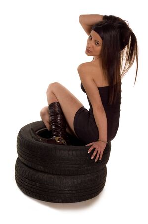 Young sexy girl sitting on a car wheels Stock Photo - 2298386