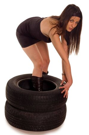 Young sexy girl with two a car wheel Stock Photo - 2318779