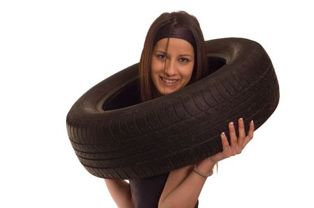 Young sexy girl holding a car wheel Stock Photo - 2318761