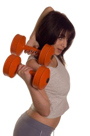 Muscular builder woman training his body with dumbbell photo