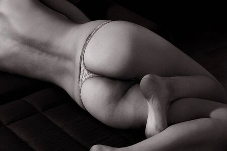 girl lying from back view, black and white photo photo