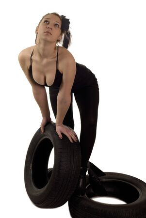Young blondie sexy girl with a car wheel Stock Photo - 2461059
