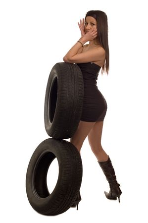 Young sexy girl holding a car wheel Stock Photo - 2461040