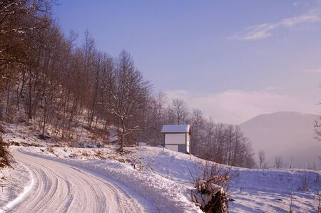 Winter road with frozen snow on it photo