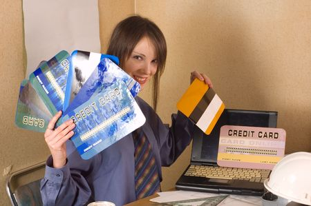 Young business woman holding online credit cards at office photo