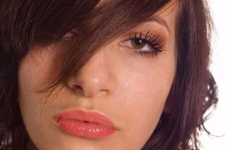 earnestly: Close up of young womans face with lips, focus on eye