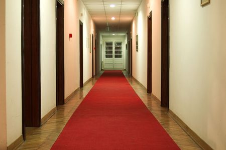 Shot of hotel hall interior with red carpet in night scene Stock Photo