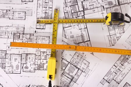 Architecture planning of interiors with metre photo